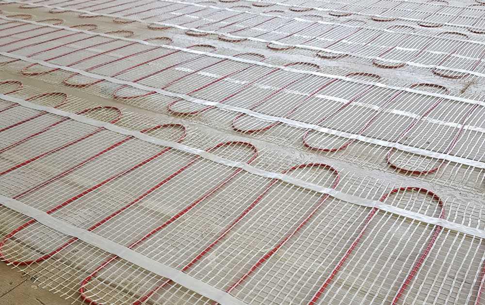 floor heating types under tile mat